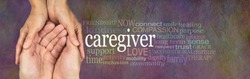 Caregivers Word Cloud - female hands gently cupped around male cupped hands beside a CAREGIVER word cloud on a rustic stone background