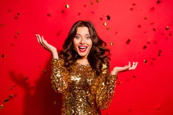 Careless, carefree, dream, dreamy concept. Beautiful, attractive, pretty, charming, modern wave hairstyle lady look at camera with raised hands up and open mouth isolated on shine red background