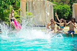 careless excited joyful sporty peoplee in swimmingpool