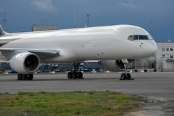 Cargo airplane parked at an airport, blank white body