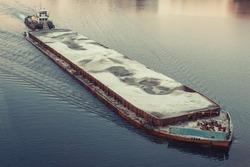 Cargo barge. Sunset.