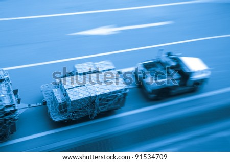 cargo car delivery on airport blur motion