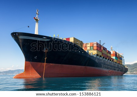cargo container ship anchored in harbor