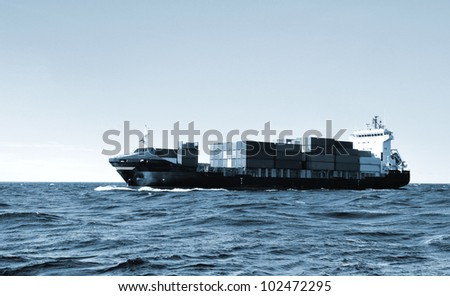 cargo container ship sailing in the sea