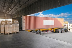 Cargo Container, Trailer Truck Parked Loading Package Boxes at Dock Warehouse. Cargo Shipment. Industry Freight Truck Transportation. Shipping Warehousing Logistics.