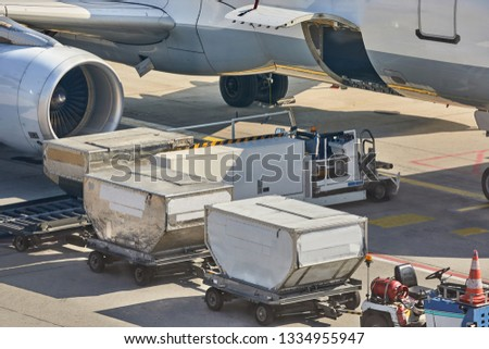 Cargo containers loaded into an airliner #1334955947