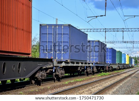 Cargo Containers Transportation On Freight Train By Railway. Intermodal Container On Train Car. Rail Freight Shipping Logistics Concept. Import - export goods from Сhina. stock photo