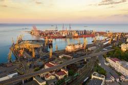Cargo crane, ship and grain dryer in port Odessa,