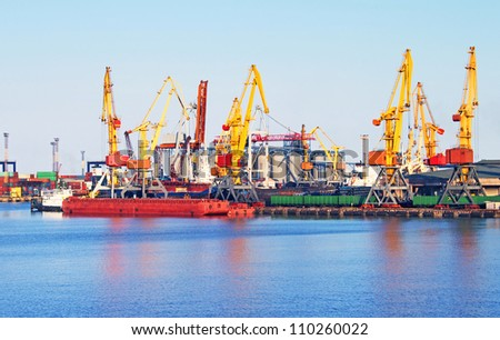 Cargo crane, ship and grain dryer in port Odessa, Ukraine - stock photo