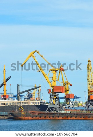 Cargo crane, ship, freight traine and coal in port - stock photo