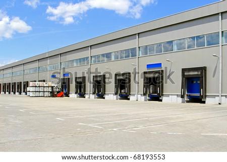 Cargo doors at big industrial warehouse building