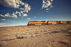Cargo locomotive railroad engine crossing Arizona desert wilderness