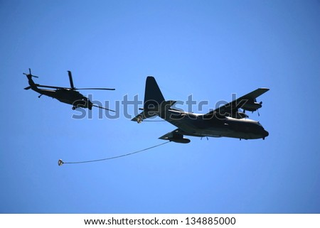 Cargo plane getting refueling in mid air