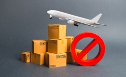 Cargo plane, many boxes and red prohibition symbol NO. Embargo trade wars. Restriction on importation, ban transit export dual-use goods to countries under sanctions. transport companies.