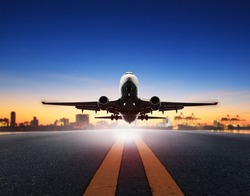 cargo plane take off from airport runways against ship port background use for air transportation and cargo logistic industry ,import ,export business