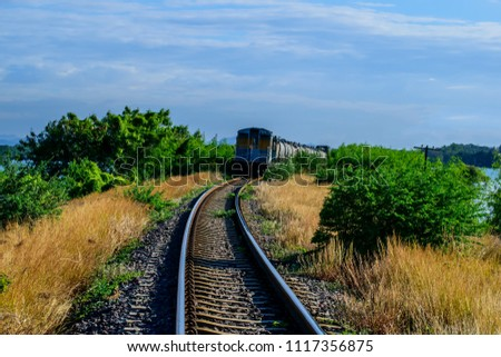 Cargo railway shipping industry and freight railroad transportation industrial.Railroad train of tanker cars transporting oil on the tracks.