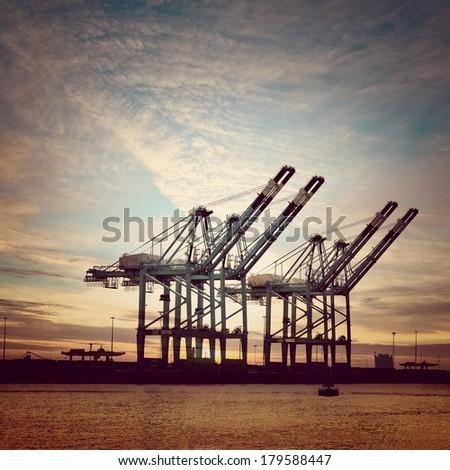 Cargo sea port. Sea cargo cranes. Sea. Sunset.