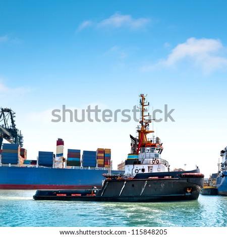 Cargo sea port. Sea cargo cranes. Tug.