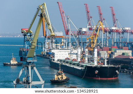 cargo ship and tug boat in port