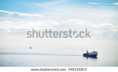 Cargo ship approaching the harbor on a day of quiet total