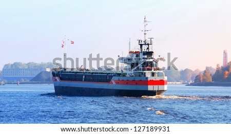cargo ship arriving in port in autumn