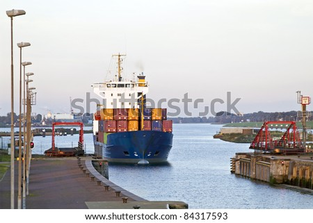 Cargo ship at IJmuiden harbor in the Netherlands - stock photo