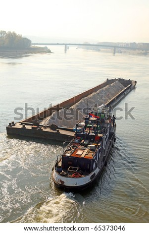 Cargo ship at the Danube, central Europe - stock photo