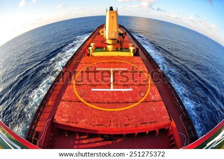 Cargo ship bulk carrier crossing ocean fish eye view half circle on top from monkey island.