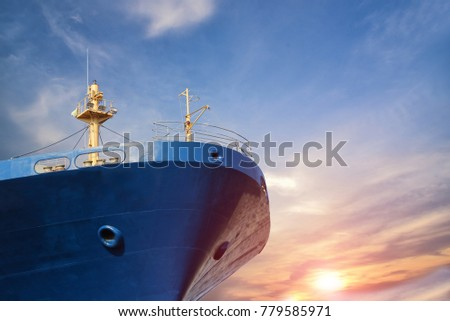 cargo ship forward close up on blue sky background