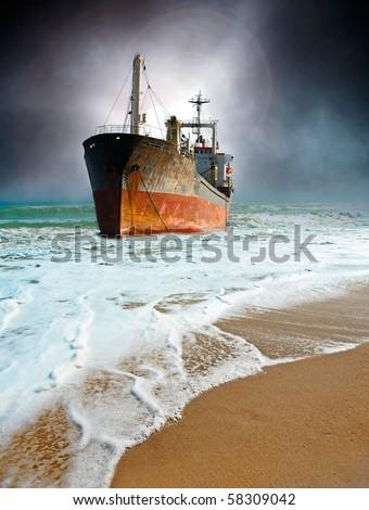 Cargo ship gotten suck on the beach #58309042