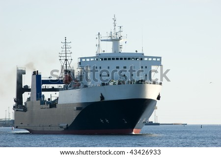 Cargo ship in harbor (logos and brandnames systematically removed)
