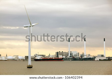 cargo ship in port at windmills