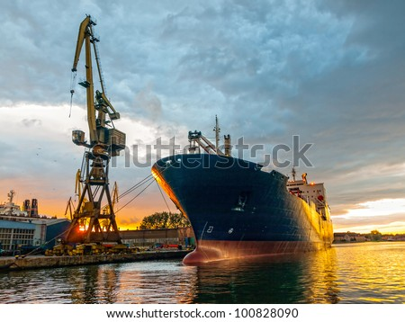 Cargo ship in the harbor at sunset. Gdansk, Poland. #100828090