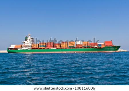 Cargo Ship Leaving the Port