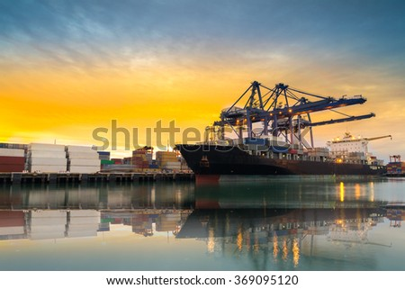 Cargo ship loading containers at sunshine