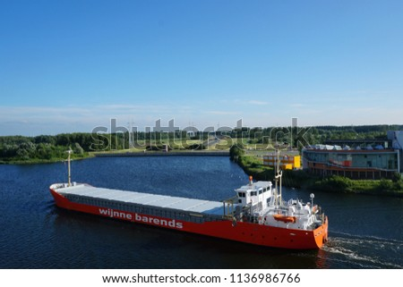 Cargo ship on Dutch waterway. Amsterdam, Netherlands. 10th June 2018. For editorial use only