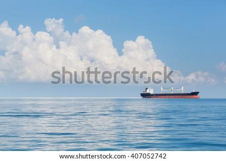 Cargo ship sailing in ocean, shipping business concept