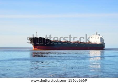 Cargo ship sailing in still water