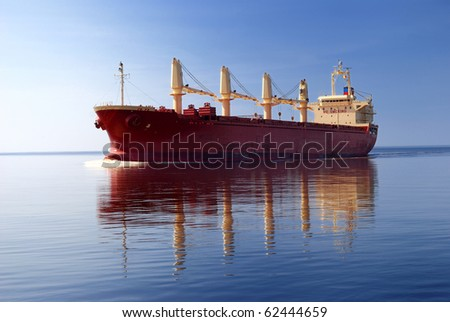 cargo ship sailing in still water #62444659
