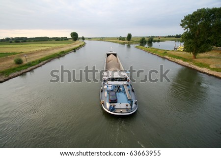 Cargo ship shipping gravel on the IJssel river in The Netherlands