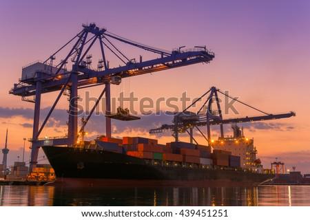 Cargo ship terminal at twilight scene, Unloading crane of cargo ship terminal, Sunrise shot.
