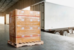 Cargo shipment loading for truck. Freight truck, Delivery service. Large cargo pallet boxes waiting to load into container truck. Logistics and Transportation