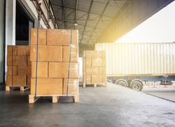 Cargo shipment loading for truck. Warehousing and Logistics.   shipment boxes. Stacked of cardboard boxes on wooden pallet for loading into container truck.