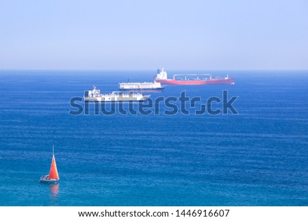 Cargo ships in the Mediterranean sea, Spain, shipping , logistics , transportation Systems.
