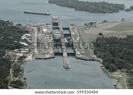 Shutterstock Cargo ships passing through Gatun Locks on the Atlantic side of the Panama Canal