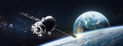 Cargo space ship on orbit of the Earth planet. Stars on background. Elements of this image furnished by NASA