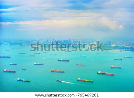 Cargo tanker ships in Singapore harbor. Singapore Downtown in the background