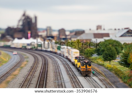 Cargo train photographed using a tilt-shift lens, resulting in a 'miniature effect' and unusual depth of field. Bethlehem, Pennsylvania, USA. - stock photo