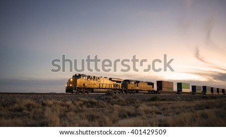 Cargo train traveling through desert.