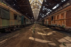 Cargo trains in old train depot eaten by rust